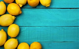 Preview wallpaper Some yellow lemons, blue wood board