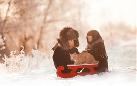 Preview wallpaper Two childs and cat in the snow