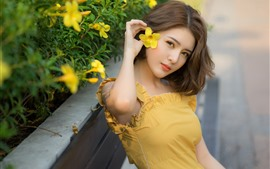 Preview wallpaper Yellow skirt Asian girl, flowers