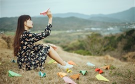 Preview wallpaper Asian girl, long hair, paper airplane, nature