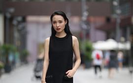 Saia preta menina chinesa, rua
