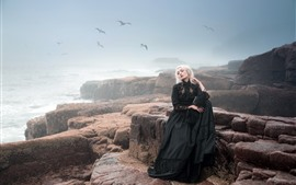 Black skirt blonde girl, fog, sea, rocks, birds