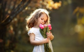 Preview wallpaper Cute little girl and pink tulips