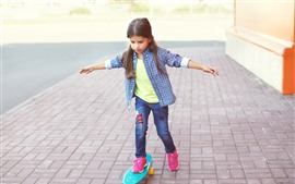 Preview wallpaper Cute little girl use skateboard