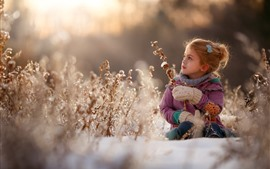 Preview wallpaper Cute little girl, winter, snow, bushes