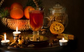 Preview wallpaper Glass cup, drinks, oranges, candles, fire, flame