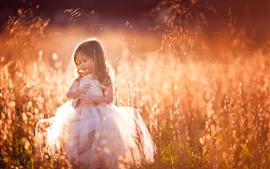Lovely little girl, curls, child, grass, summer