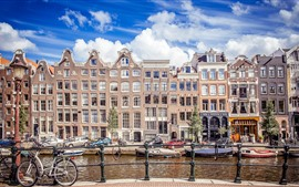 Preview wallpaper Netherlands, Amsterdam, city, buildings, river, fence, clouds