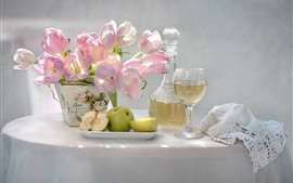 Pink tulips, green apples, wine, table