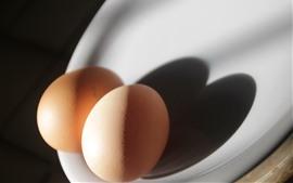Dois ovos, luz, sombra