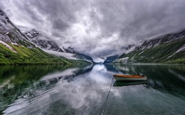 Beautiful nature landscape, mountains, clouds, lake, boat