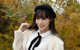 Chinese girl, white dress, black hat