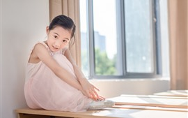 Preview wallpaper Cute little girl sit on table, window