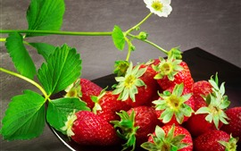 Fresh strawberry, flowers, delicious fruit