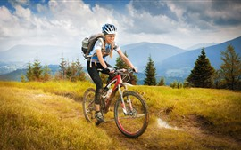 Preview wallpaper Girl ride bike, travel, grass, trees, mountains