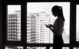 Girl use phone, window, black and white picture