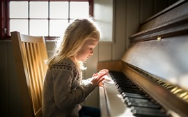 Preview wallpaper Little girl play piano