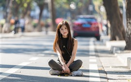 Preview wallpaper Long hair Chinese girl sit on ground