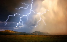 Preview wallpaper Mountains, grass, clouds, lightning, storm