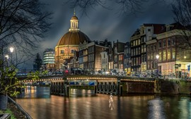 Preview wallpaper Netherlands, Amsterdam, Church, river, bridge, bikes, night, lights