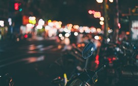 Night, street, light circles, motorcycle mirror