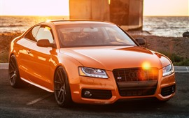 Orange Audi car front view, sunlight, highway