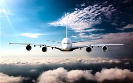 Passenger plane front view, flight, clouds
