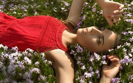 Preview wallpaper Red skirt girl lying on flowers, sunlight