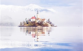 Preview wallpaper Slovenia, lake, island, church, mountains, snow, water reflection