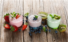 Preview wallpaper Three cups yogurt, kiwi, blueberries, strawberry