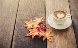 White cup, coffee, maple leaves, wood board
