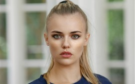 Young blond girl, face, green eyes