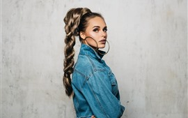 Blonde girl, braids, big earring, jacket