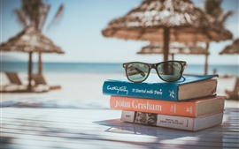 Books, glasses, tropical