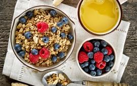 Desayunos, cereales, arándanos, frambuesas, zumos.