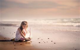 Cute little girl play toy boat, sea, beach