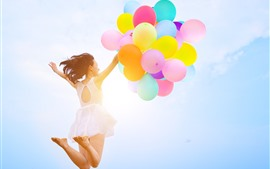 Preview wallpaper Girl jumping, colorful balloons, sky