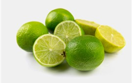 Green limes, fruit, gray background