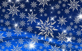 Many white snowflakes, stars, blue background