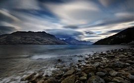 Preview wallpaper New Zealand, Lake Wakatipu, rocks, mountains, clouds