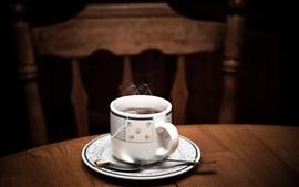 Uma xícara de chá, vapor, mesa