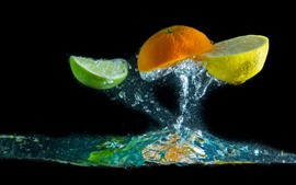 Preview wallpaper Orange and lemon slice, water splash