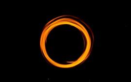 Orange light circle, black background