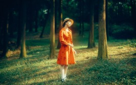 Preview wallpaper Orange skirt girl, forest, sunshine, hazy