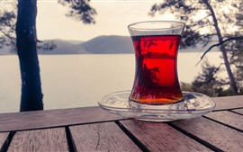 Preview wallpaper Red tea, glass cup, bench, river