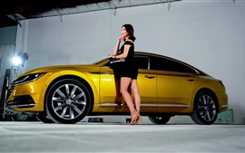 Preview wallpaper Volkswagen yellow car side view, black skirt girl