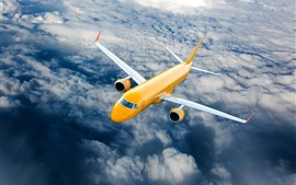 Preview wallpaper Yellow passenger plane, flight, sky