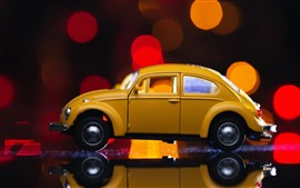 Preview wallpaper Yellow toy car, light circles, glare