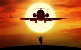 Airplane and man, silhouette, sunset, sun