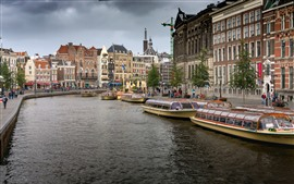 Preview wallpaper Amsterdam, Netherlands, city, river, boats, houses, clouds